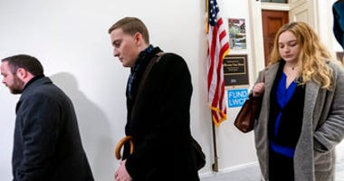 Deputy Chief of Staff Justin O'Leary, center, joins other top aides to Jeff Van Drew, a House Democrat who plans to switch and become a Republican, as leave their office after turning in their joint letter of resignation. (AP Photo/J. Scott Applewhite)