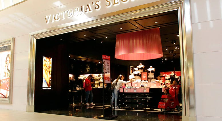 FILE - In this June 7, 2017 file photo, shoppers look at merchandise at a Victoria's Secret store.  (AP Photo/Alan Diaz, File)