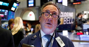 Trader Steven Kaplan watches the numbers at the closing bell on the floor of the New York Stock Exchange, Monday, March 2, 2020. (AP Photo/Richard Drew)