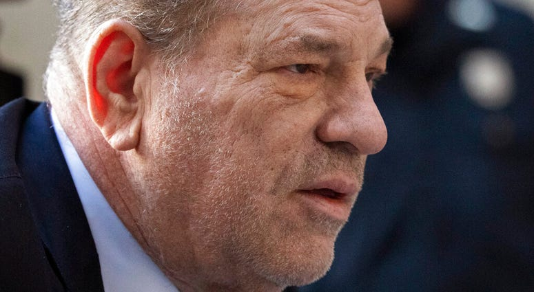 Harvey Weinstein arrives at a Manhattan court as jury deliberations continue in his rape trial, Friday, Feb. 21, 2020 in New York. (AP Photo/Mark Lennihan)