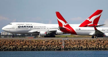FILE - In this Aug. 20, 2015 file photo, two Qantas planes taxi on the runway at Sydney Airport in Sydney, Australia. Some Asian airlines have rerouted flights to the Middle East to avoid Iranian airspace. (AP Photo/Rick Rycroft, File)