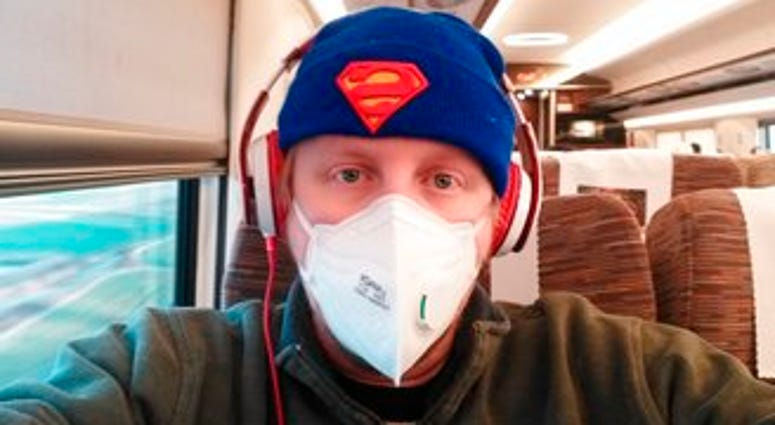 """American citizen James Dickey sits on a train on his way back to his home in Changsha, China. Dickey said he was """"really scared"""" and trying to arrange for his daughter and ex-wife to leave Wuhan for the United States. (James Dickey via AP)"""