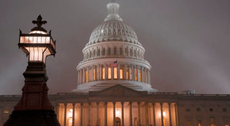 The U.S. Capitol in Washington is shrouded in mist, Friday night, Dec. 13, 2019. (AP Photo/J. Scott Applewhite)