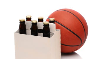 Six pack of beer bottles with a basketball. Steven Cukrov | Dreamstime.com