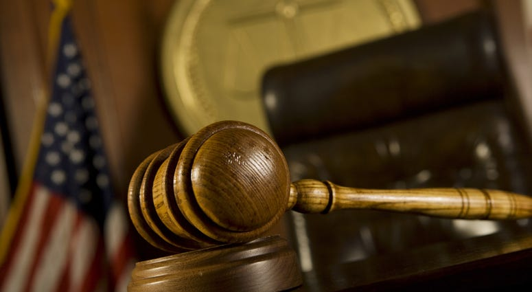 Closeup of gavel in court room. (Dreamstime)