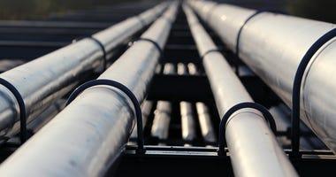 Crude oil silver pipeline transportation to refinery. © Kodym | Dreamstime.com