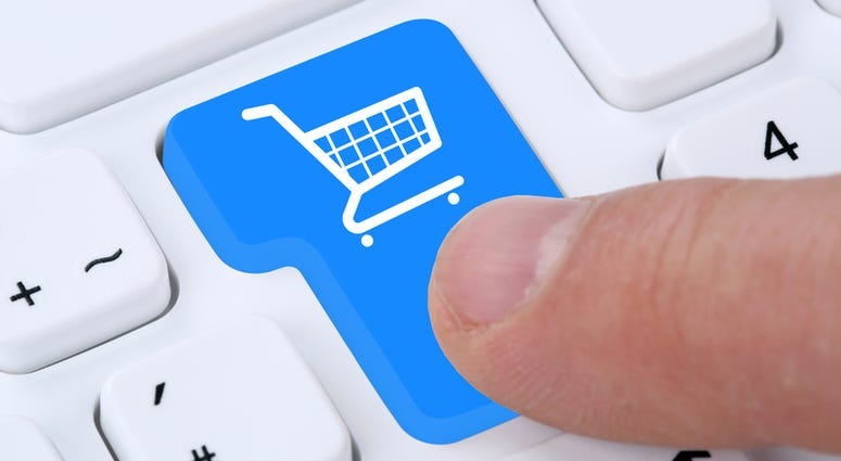 Online shopping buying order internet shop concept with shopping cart. © Boarding1now | Dreamstime.com