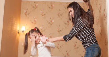 Strict mother hit her little daughter with belt.  © Nomadsoul1 - Dreamstime.com