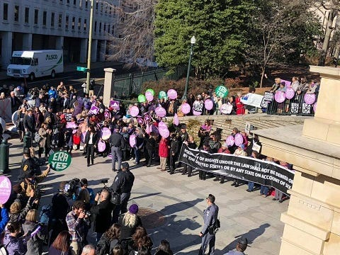 Equal Rights Amendment advocates rally at door of State Capitol. (Matt Demlein, WRVA)