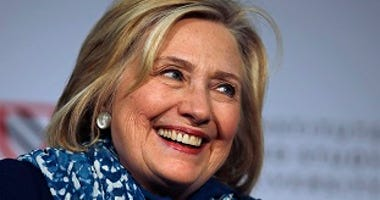 FILE - In this May 25, 2018 file photo, Hillary Clinton smiles as she is introduced at Harvard University in Cambridge, Mass.  (AP Photo/Charles Krupa)