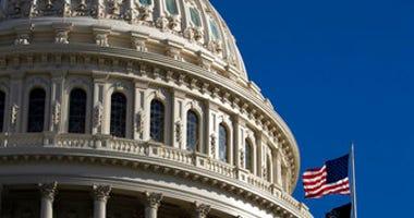 The U.S. flag flies over the U.S. Capitol in Washington, Sunday, Jan. 19, 2020. (AP Photo/Manuel Balce Ceneta)