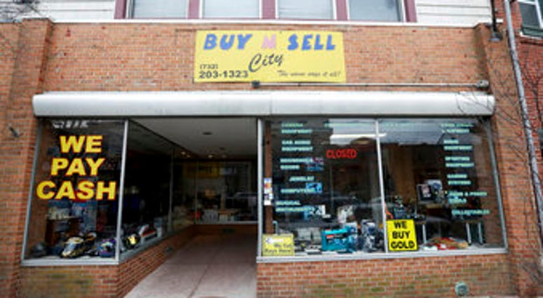 This Sunday, Dec. 15, 2019 photo shows the family-owned Buy n Sell pawn shop searched by the FBI over the weekend in Keyport, N.J. (Ed Murray/NJ Advance Media via AP)