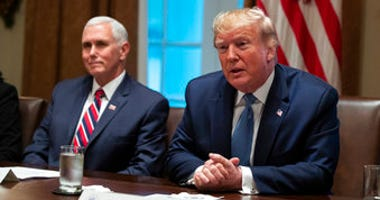 Vice President Mike Pence listens as President Donald Trump speaks during a roundtable on school choice in the Cabinet Room of the White House, Monday, Dec. 9, 2019, in Washington. (AP Photo/ Evan Vucci)