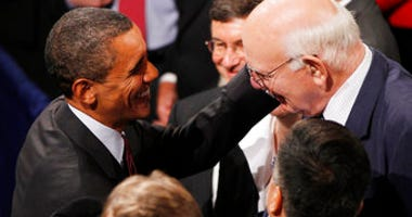 FILE - In this July 21, 2010, file photo President Barack Obama greets Paul Volcker after Obama signed the Dodd-Frank Wall Street Reform and Consumer Protection financial reform bill. (AP Photo/Charles Dharapak, File)