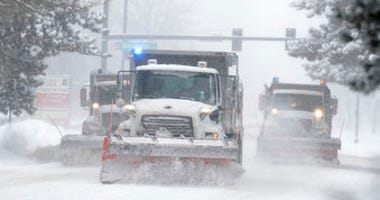 City of Denver snowplows clear the eastbound lanes of Speer Blvd. as a storm packing snow and high winds sweeps in over the region Tuesday, Nov. 26, 2019. (AP Photo/David Zalubowski)