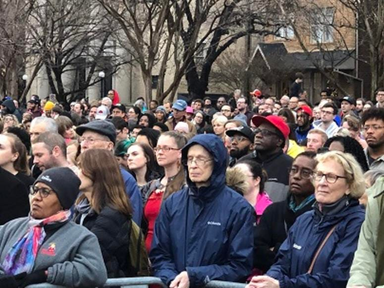 "A crowd lines Arthur Ashe Boulevard to watch the unveiling of ""Rumors of War"" on December 10, 2019. (Matt Demlein, WRVA)"