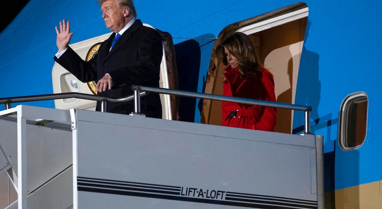 President Donald and first lady Melania Trump arrive at London Stansted Airport to attend the NATO summit, Monday, Dec. 2, 2019, in London. (AP Photo/ Evan Vucci)