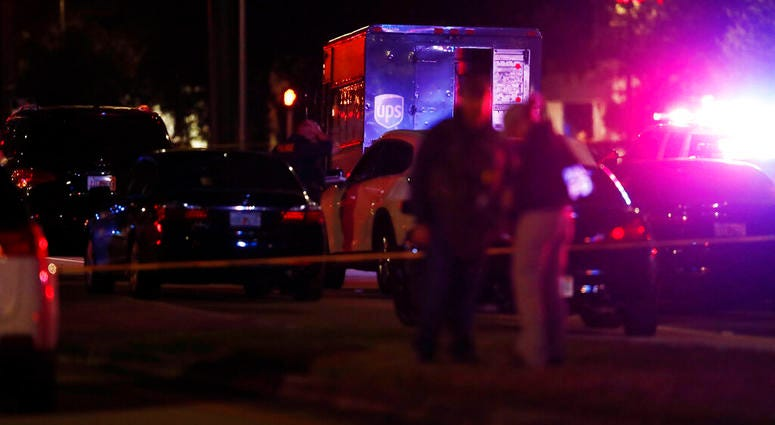 Authorities investigate the scene of a shooting Thursday, Dec. 5, 2019, in Miramar, Fla. Four people, including a UPS driver, were killed Thursday after robbers stole the driver's truck and led police on a chase that ended in gunfire at a busy Florida int