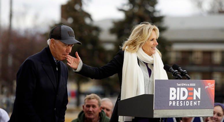 Joe Biden bites wife's hand