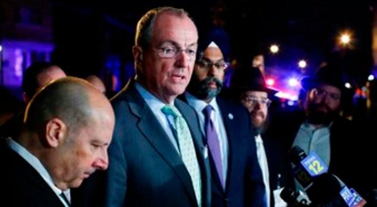 New Jersey Gov. Phil Murphy speaks with media near the scene following reports of gunfire, Tuesday, Dec. 10, 2019, in Jersey City, N.J. (AP Photo/Eduardo Munoz Alvarez)