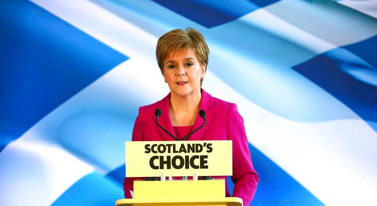 Scottish First Minister Nicola Sturgeon speaks to supporters in Edinburgh, Scotland, Dec. 13, 2019. Prime Minister Boris Johnson has led his Conservative Party to a landslide victory in Britain's election dominated by Brexit. (Jane Barlow/PA via AP)