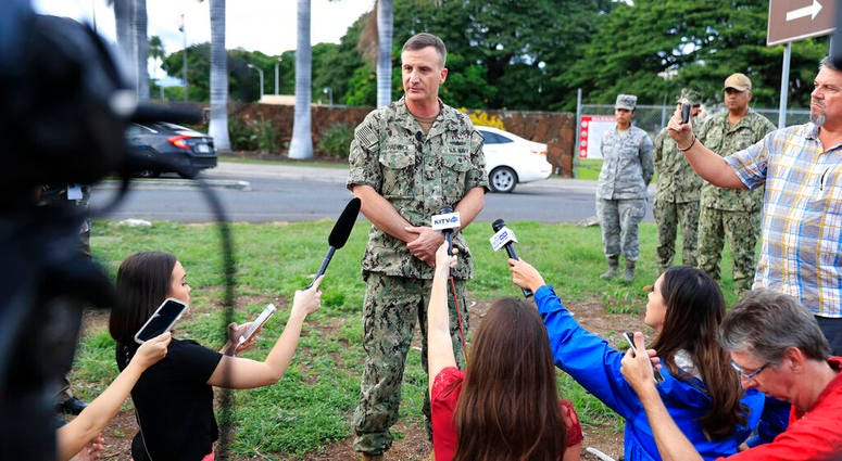 U.S. Navy Rear Adm. Robb Chadwick speaks to the media at the main gate at Joint Base Pearl Harbor-Hickam, Wednesday, Dec. 4, 2019, in Hawaii, following a shooting. (AP Photo/Marco Garcia)