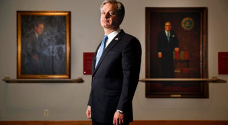 FBI Director Christopher Wray poses for a photo after an interview with The Associated Press, Monday, Dec. 9, 2019, in Washington. (AP Photo/Jacquelyn Martin)