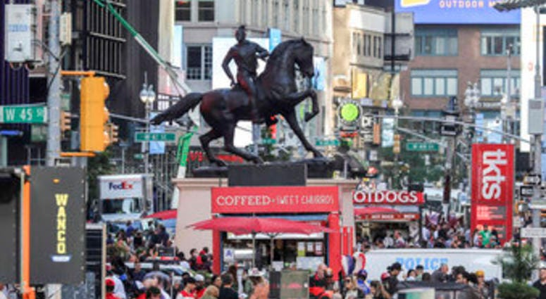 """FILE - In this Sept. 27, 2019 file photo, a bronze sculpture, """"Rumors of War,"""" by artist Kehinde Wiley, appears in Times Square in New York. (AP Photo/Bebeto Matthews, File)"""