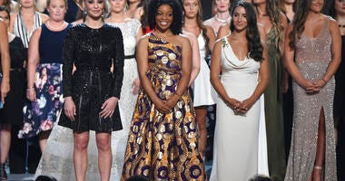 Former gymnast Sarah Klein, former Michigan State softball player Tiffany Thomas Lopez and gymnast Aly Raisman, from left in front, and others who suffered sexual abuse accept the Arthur Ashe Award for Courage at the ESPY Awards. (Photo by Phil McCarten/I