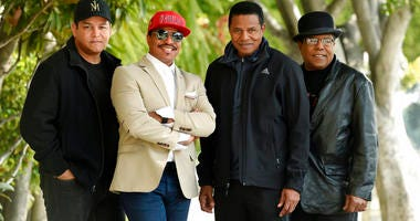 Marlon Jackson, second from left, Tito Jackson, second from right, and Jackie Jackson, far right, brothers of the late musical artist Michael Jackson, and Tito's son Taj, far left, pose together. (Photo by Chris Pizzello/Invision/AP)