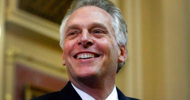 """FILE - In this Jan. 10, 2018 file photo, Virginia Gov. Terry McAuliffe delivers his final """"State of the Commonwealth"""" address to the General Assembly at the Capitol in Richmond, Va.  (Bob Brown/Richmond Times-Dispatch via AP)"""