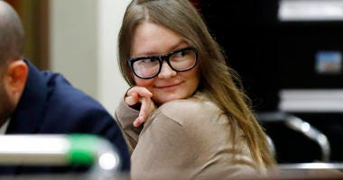 Anna Sorokin sits at the defense table in New York State Supreme Court, in New York, Wednesday, March 27, 2019. Sorokin, who claimed to be a German heiress, is on trial on grand larceny and theft of services charges. (AP Photo/Richard Drew)