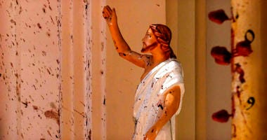 Blood stains are seen on the wall and on a Jesus Christ statue at the St. Sebastian's Church after blast