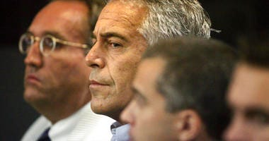 FILE - In this July 30, 2008 file photo, Jeffrey Epstein, center, appears in court in West Palm Beach, Fla. The wealthy financier pleaded not guilty in federal court in New York on Monday, July 8, 2019.  (Uma Sanghvi/Palm Beach Post via AP, File)
