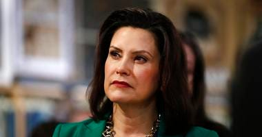 FILE - In this March 18, 2019, file photo, Michigan Gov. Gretchen Whitmer listens to Democratic presidential candidate Sen. Kirsten Gillibrand, D-N.Y., in Clawson, Mich. (AP Photo/Paul Sancya, File)