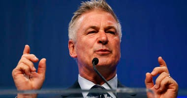 FILE - In this Monday, Nov. 27, 2017, file photo, actor Alec Baldwin speaks during the Iowa Democratic Party's fall gala, in Des Moines, Iowa.  (AP Photo/Charlie Neibergall, File)