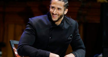FILE - In this Oct. 11, 2018, file photo, former NFL football quarterback Colin Kaepernick smiles on stage during W.E.B. Du Bois Medal ceremonies at Harvard University, in Cambridge, Mass.  (AP Photo/Steven Senne, File)