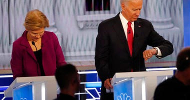 Democratic presidential candidate Sen. Elizabeth Warren, D-Mass., left, and Democratic presidential candidate former Vice President Joe Biden during a commercial break in a Democratic presidential primary debate.(AP Photo/John Bazemore)