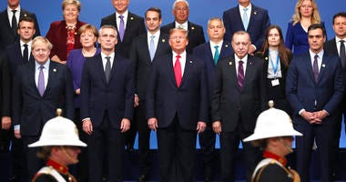 From front row left, British Prime Minister Boris Johnson, NATO Secretary General Jens Stoltenberg, U.S. President Donald Trump, Turkish President Recep Tayyip Erdogan and Spanish Prime Minister Pedro Sanchez attend a ceremony event.   (AP Photo/Francisco