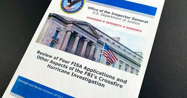 The cover page of the report issued by the Department of Justice inspector general is photographed in Washington, Monday, Dec. 9, 2019. (AP Photo/Jon Elswick)