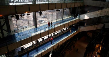 In this Friday, Dec. 20, 2019, photo, people visit the Newseum, in Washington. (AP Photo/Jacquelyn Martin)