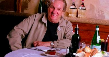 FILE - In this July 28, 2001 file photo, Danny Aiello poses for a photo at Gigino restaurant in New York. Aiello died Thursday, Dec. 12, 2019 after a brief illness. He was 86. (AP Photo/Jim Cooper, File)