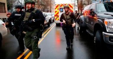 Law enforcement arrives at the scene following reports of gunfire, Tuesday, Dec. 10, 2019, in Jersey City, N.J. (AP Photo/Eduardo Munoz Alvarez)