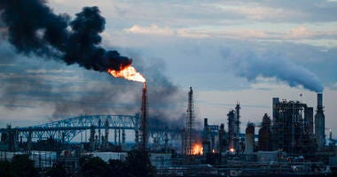 Flames and smoke emerge from the Philadelphia Energy Solutions Refining Complex in Philadelphia, Friday, June 21, 2019. (AP Photo/Matt Rourke)