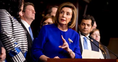 House Speaker Nancy Pelosi of Calif., accompanied by House Congress members speaks at a news conference to discuss the United States Mexico Canada Agreement (USMCA) trade agreement, Tuesday, Dec. 10, 2019, on Capitol Hill. (AP Photo/Andrew Harnik)