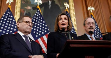 Speaker of the House Nancy Pelosi, D-Calif., flanked by House Judiciary Committee Chairman Jerrold Nadler, D-N.Y., left, and House Foreign Affairs Committee Chairman Eliot Engel, D-N.Y., speaks reporters at the Capitol. (AP Photo/J. Scott Applewhite)