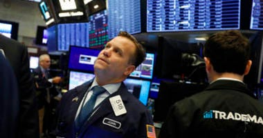 FILE - In this Nov. 14, 2019, file photo trader John Elliott works on the floor of the New York Stock Exchange. (AP Photo/Richard Drew, File)
