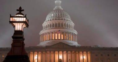 The U.S. Capitol in Washington is shrouded in mist, Friday night, Dec. 13, 2019. (AP Photo/J. Scott Applewhite)