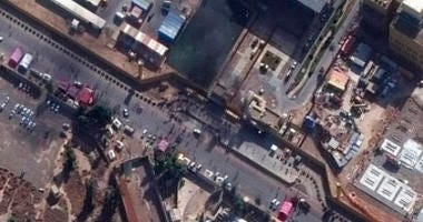This Wednesday, Jan. 1, 2020, image provided by Maxar Technologies shows black smoke coming out of the U.S. Embassy compound in Baghdad. (Satellite image ©2020 Maxar Technologies via AP)