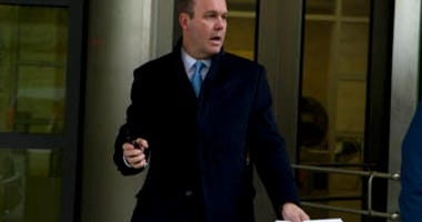 Former Deputy Trump campaign aide Rick Gates leaves the federal court in Washington, Tuesday, Dec. 17, 2019. A judge on Tuesday sentenced former Trump campaign official Rick Gates to 45 days in jail. (AP Photo/Jose Luis Magana)